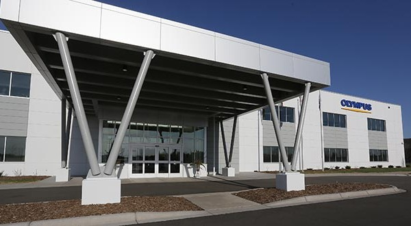 The state's strong showing in the Mid-America Business Conditions Index counters a recent sluggish stretch. This April 2015 file photo shows Olympus Surgical Technologies of America's new building in Brooklyn Park on its grand opening day, where it planned to house 100 new jobs. (File photo: Bill Klotz)