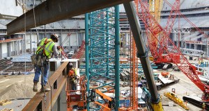 Crews place a beam on the northwest end of U.S. Bank Stadium in Minneapolis. The new home for the Minnesota Vikings football team is a year away from completion. (Staff photo: Bill Klotz)