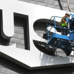 The first U.S. Bank Stadium sign was installed on the east end of the building Monday. (Staff photo: Bill Klotz)