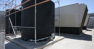 Data centers require a lot of energy for heating, cooling and keeping servers on 24/7. DataBank's new 90,000-square-foot center in Eagan has water tanks (at left) for the rooftop cooling units and back-up generators (at right) for use during power outages. (File photo: Bill Klotz)