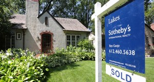 "Home sales in the 13-county Twin Cities region increased 17.7 percent in July from the previous period in 2014. This home, at 4124 Chowen Ave. S. in Minneapolis, sported a ""sold"" sign this week. (Staff photo: Bill Klotz)"