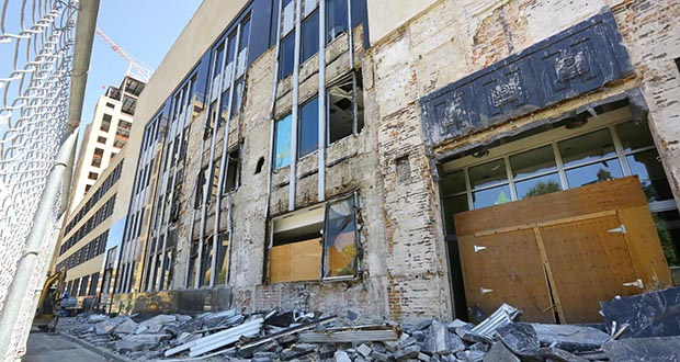Staff photo: Bill Klotz  A sidewalk is filled with debris from the facade of the Star Tribune building at 425 Portland Ave. S. in downtown Minneapolis. Demolition of the nearly 100-year-old building began this week.