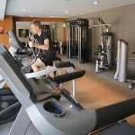On VELO's second floor, there is a fitness center, pictured, and a room where residents can follow video exercise programs on a large screen.