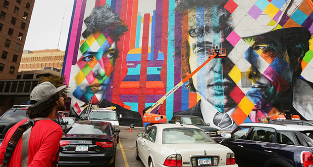 Brazilian artist Eduardo Kobra and his team have worked through the week on a mural showcasing Bob Dylan in downtown Minneapolis, covering up a blank wall on the side of the 15 Building at 15 S. Fifth St. and Hennepin Avenue. (Staff photo: Bill Klotz)