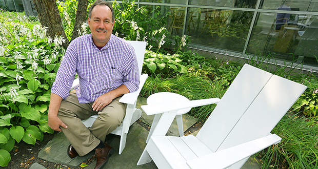 STAFF PHOTO: BILL KLOTZ Steve Freeman, president of the Sustainable Furnishings Council, sits on a chair made of recycled plastic at the Room & Board campus where he works in Golden Valley.
