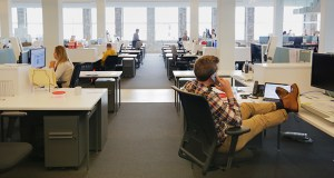 Mithun employees work in an individual desk area within the company's new space in the 510 Marquette building, downtown Minneapolis. The space is designed to create a bright, open and collaborative work setting. (Staff Photo: Bill Klotz)