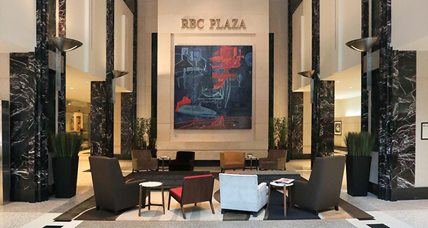The RBC Tower lobby has been spruced up. A seating area off Sixth Street has been added and several framed art pieces decorate the walls, on loan from RBC. (Staff photo: Bill Klotz)