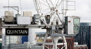 A Quintain sign hangs off a crane Monday at the Emerald Gardens site at the Wembley Park retail and residential complex, a joint development venture by Quintain Estates and Development Plc and Keystone Developers SA, in London. Lone Star Funds raised its offer for Quintain Estates & Development to 32 percent above the share price after hedge fund Elliott Associates LP pushed for a higher price. (Bloomberg News: Jason Alden)