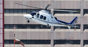 """A North Memorial helicopter prepares to land on top of a parking ramp across Park Avenue from HCMC. A new """"helistop"""" under construction atop the medical center's Red Building will ease the transport of patients flown in by helicopter. (Staff photo: Bill Klotz)"""