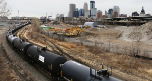West of downtown Minneapolis, a freight train runs along tracks that travel under Target Field. Trains throughout Minnesota would benefit from a proposed rail bypass in Willmar, which would speed up BNSF freight traffic. File Photo: Bill Klotz