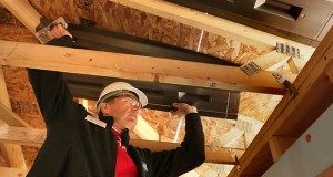 Wells Fargo CEO Dave Kvamme on Monday installs attic ventilation in a Twin Cities Habitat for Humanity home under construction at 2958 Knox Ave. N. in Minneapolis. (Staff photo: Bill Klotz)