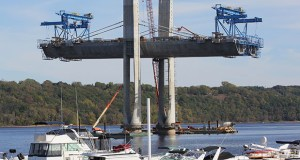 Workers install the second set of stay cables at Pier 8 for the St. Croix Crossing, which is under construction between Oak Park Heights, Minnesota, and St. Joseph, Wisconsin. Pier 8 is closest to the Minnesota shore. (Staff photo: Bill Klotz)