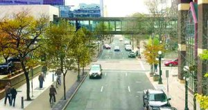 A rendering shows a bike and pedestrian trail separated from vehicle traffic on Jackson Street in downtown St. Paul. Complete reconstruction of the street is expected to begin in May 2016 as the first phase of a downtown bicycle and pedestrian loop. (Submitted image: City of St. Paul)