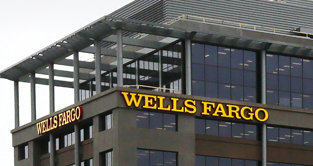 The sign on the side of the Wells Fargo tower in downtown Minneapolis isn't the subject of the Vikings' lawsuit against the bank. The team claims that an illuminated logo which lies flat on the rooftop will take away from the U.S. Bank stadium in fly-over shots. Staff photo: Bill Klotz