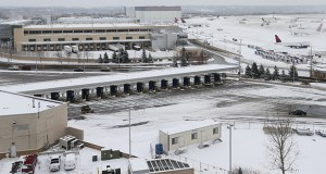 The new 5,000-space parking structure at the Minneapolis-St. Paul International Airport's Terminal 1 will be built in the area between the red and blue ramps and the post office building (seen in the background). File photo: Bill Klotz