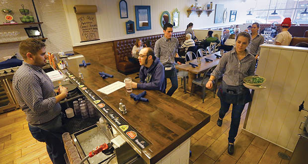 A proposal to ease liquor sale restrictions in St. Paul was shaped in part by feedback from David Burley, who owns the Highland Grill and said his Highland Park business would be more competitive if it could provide patrons the cocktails they often request rather than just beer and wine. (Staff photo: Bill Klotz)