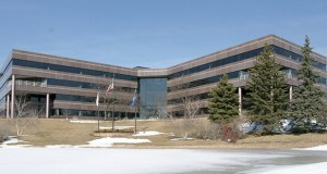 Associated Financial Group plans to take up to a year to build out the interior of this 93,000-square-foot, four-story office building at 6000 Clearwater Drive in Minnetonka to create space for 250 employees. Submitted photo: CoStar