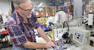 In this 2012 photo, Capitol Safety worker Wayne Voth assembles a harness at the company's facility in Red Wing. Minnesota manufacturers reported a dim growth outlook again in December as a strong U.S. dollar continued to bog down exports. File photo.