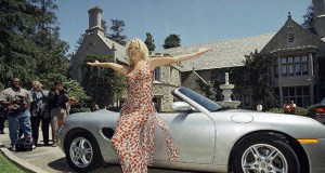 Victoria Silvstedt poses May 1, 1997, with her brand new Porsche in front of the Playboy Mansion in Beverly Hills, California. The Playboy Mansion is up for sale for $200 million, but longtime resident Hugh Hefner wants to stay put. AP file photo