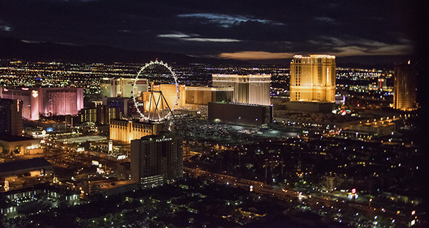 The High Roller Ferris wheel, center, and hotels stand on The Strip on Aug. 5, 2015, in this aerial photograph taken at dusk above Las Vegas. (Bloomberg file photo)