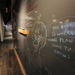 "One of the building's 30 ""huddle"" rooms features a floor to ceiling blackboard."