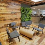 This huddle room area is inspired by Mears Park: It has a skylight illuminating two plant-filled living walls graced by reclaimed wood.