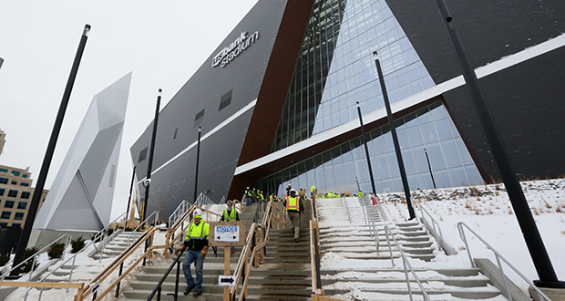 Repairs on snow gutters will require crews to temporarily remove U.S. Bank Stadium signs on the Vikings stadium, which is under construction in downtown Minneapolis. Staff photo: Bill Klotz