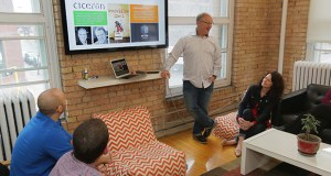 Ciceron founder and CEO Andrew Eklund leads a group of employees in a brainstorming session at the company's office in downtown Minneapolis. Staff photo: Bill Klotz