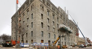 """The Institute on Metropolitan Opportunity cites the conversion of the A-Mill Artist Lofts, shown here during its renovation in December 2014, as a prime example of a POSH, or """"Politically Opportune Subsidized Housing,"""" project. (File photo: Bill Klotz)"""