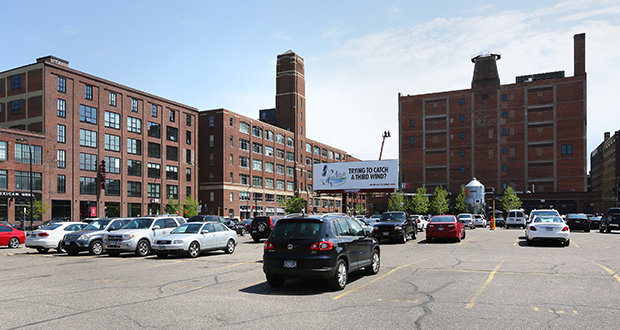 United Properties plans to build up to a 10-story office building on the eastern half of a parking lot along the 700 block of Washington Avenue in the North Loop neighborhood of Minneapolis. The project would be next to the Loose-Wiles Building (background) that United owns at 701 Washington Ave. N. (Staff photo: Bill Klotz)