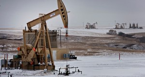 A pumpjack operates at an oil well Feb. 15, 2015, in Williston, North Dakota. (Bloomberg file photo)