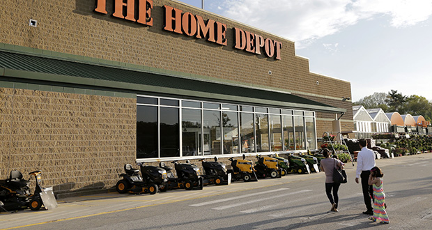 People approach an entrance to a Home Depot store. (AP file photo: Steven Senne)