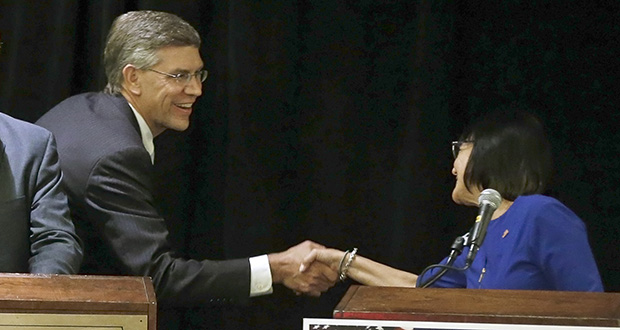 U.S. Rep. Erik Paulsen shakes hands with state Sen. Terri Bonoff moments before their debate Wednesday at a TwinWest Chamber of Commerce forum in Minnetonka. Bonoff, a Democrat, is hoping to unseat Paulsen, a Republican, in Minnesota's 3rd Congressional District. (AP photo: Jim Mone)