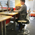 Some work stations provide the option of sitting or standing while working.