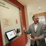 Tom Montminy, Managing Partner - Minneapolis/St Paul at PwC, demonstrates how to use the Kiosk Information Center.