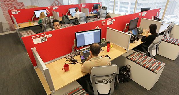 """No one at PwC's Minneapolis headquarters has a dedicated office or desk. Instead, everyone reserves a desk, office or conference room through a """"hoteling"""" system online. (Staff photo: Bill Klotz)"""