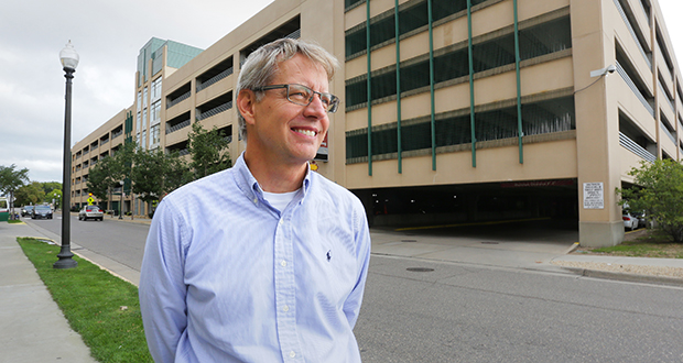 "Dave Burrill, who manages the Midtown Exchange in Minneapolis for Ryan Cos. US Inc., says benchmarking software helped him see the impact of motion detectors and LED lighting in the building's parking ramp. ""It was unbelievable … we saw huge savings,"" Burrill said. (Staff photo: Bill Klotz)"