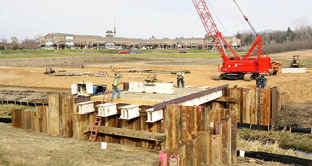Site grading was underway Thursday for a mixed-use project at the southeast quadrant of Highway 110 and Dodd Road in Mendota Heights that will bring a 139-unit apartment complex and 11,000 square feet of new retail to Mendota Plaza. (Staff photo: Bill Klotz)