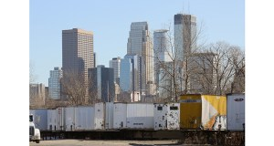 The Minneapolis skyline looms over one of three Harrison neighborhood properties the city wants to sell for redevelopment. The properties now host storage for tractor trailers and vacant commercial buildings. (Staff photo: Bill Klotz)