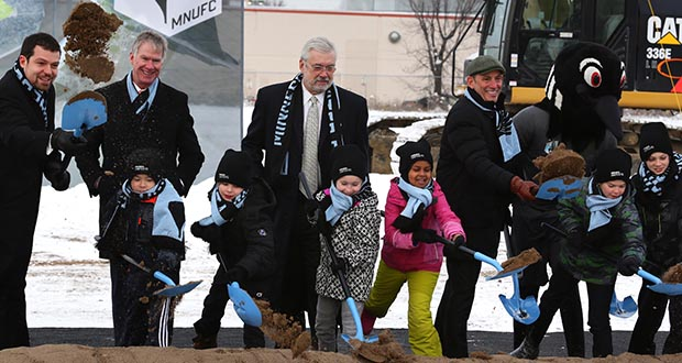 Minnesota United FC owner Bill McGuire (center), along with St. Paul Mayor Chris Coleman at left and Major League Soccer Commissioner Don Garber at right, shovel dirt with youth soccer players during the team's groundbreaking Monday for its stadium in St. Paul's Midway area. (Staff photo: Bill Klotz)