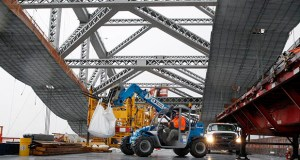 A worker lifts materials Nov. 15 as construction continues on the new roadway deck of the Bayonne Bridge in Bayonne, New Jersey. Lobbyists are beginning to worry that there won't be a grand infrastructure plan from the Trump administration. (AP file photo)
