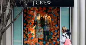A shopper passes a display in the window of a J. Crew store Feb. 10 in the Shadyside shopping district of Pittsburgh. The Commerce Department reported Wednesday that clothing stores, sporting goods retailers and department stores all reported lower sales in February. (AP Photo: Gene J. Puskar)