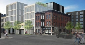 The comparatively small Roe Wolfe and Commutator Foundry Co. buildings at 121 and 125 First St. N. in Minneapolis would be preserved as a development group headed by Howard Bergerud builds 156 new apartments and about 50,000 square feet of new and renovated office space. (Submitted image: Snow Kreilich Architects)