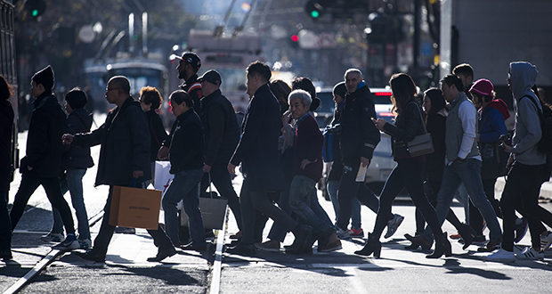 Pedestrians cross Market Street on Dec. 26, 2016, in San Francisco. Pedestrians now account for 15 percent of all traffic fatalities, according to data from the Governor's Highway Safety Association. (Bloomberg file photo)