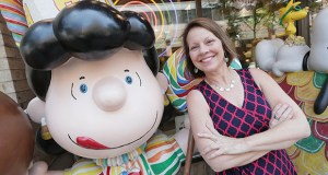 """Brenda """"B"""" Kyle poses with Peanuts character Lucy at downtown St. Paul's Candyland store. As of Aug. 1, she will leave the St. Paul Port Authority for a new position as president and CEO of the St. Paul Area Chamber of Commerce. (Staff photo: Bill Klotz)"""