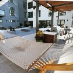 A hammock hangs next to the grilling area on the third-floor patio.