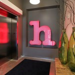 First-floor elevator lobby with the H from the old Cheapo store sign.