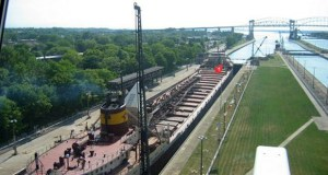 In this June 2005 photo, an ore ship passes through the Soo Locks in Sault Ste. Marie, Michigan. Vessels large and small pass through the structures more than 7,000 times a year. Officials from the Great Lakes states are making a renewed push to win approval of a long-stalled proposal for adding a new lock to the Soo Locks complex, a critical chokepoint that connects Lake Superior to the lower Great Lakes. Only one of the two working locks there handles large iron ore boats. (AP file photo)