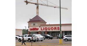 The Big Top Liquor building at 1574 University Ave. W. in St. Paul is the only structure on the Midway Shopping Center site considered substandard, according to a study by LHB. The Minnesota United FC's soccer stadium is under construction behind Big Top Liquor. (Staff photo: Bill Klotz)