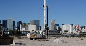 A drilling rig sits on the Raiders' proposed stadium site Aug. 17 in Las Vegas. Commissioners in Nevada's Clark County voted unanimously Thursday to approve use permits required for the proposed 65,000-seat stadium. (AP Photo: John Locher)
